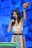 Selena Gomez proudly raised her Kids' Choice Award during the 2012 show.