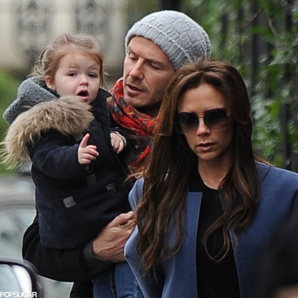 Harper Beckham was bundled up in London with her parents.