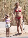 Gwyneth Paltrow wore a red bikini for a July 2011 visit to Sardinia, Italy, with her daughter, Apple, and her son, Moses.