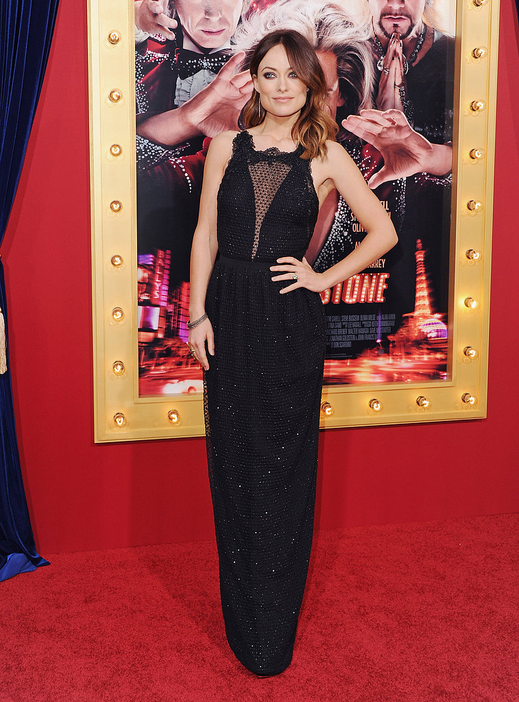 Olivia Wilde attended the LA premiere of The Incredible Burt Wonderstone wearing a gorgeous black Gucci Pre-Fall 2013 gown paired with Charlotte Olympia peep-toe platform pumps.