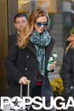 Jessica Alba wore a blue scarf and matching sunglasses.