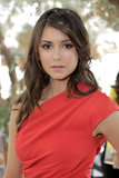 Nina Dobrev wore loose curls to the 25 Most Powerful Stylists Luncheon, hosted by The Hollywood Reporter and Jimmy Choo.