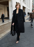 While strutting the streets of NYC, Karlie wore head-to-toe black and accessorized via a Christian Dior bag and strappy sandals.