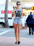 Candice Swanepoel's denim cut-offs, concert tee, and bandana headband lit up the streets of Miami.