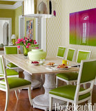 This traditional dining room has modern flair with several shades of green complemented by hot-pink accents.  Source: Maura Mcevoy for House Beautiful