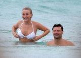 Ryan Seacrest and Julianne Hough went for a smiley swim during a January trip to St. Barts.