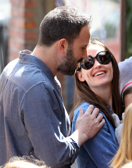 Ben Affleck put his hand on Jennifer Garner's shoulder during a family outing in LA's Pacific Palisades neighborhood in March.