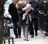 Sienna Miller took a Sunday stroll with Marlowe in her arms.