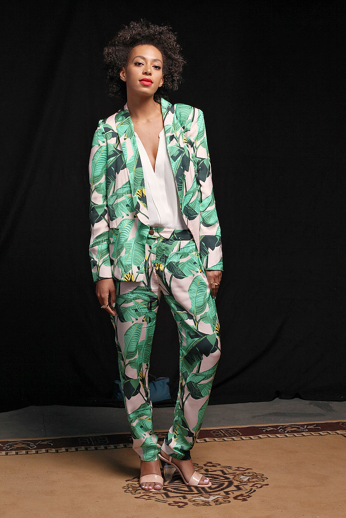 Solange Knowles channeled her signature style in a head-to-toe printed suit when she posed for portraits backstage at Fader Fort.