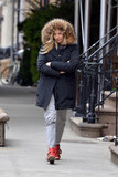 Sienna Miller bundled up in a heavy coat.