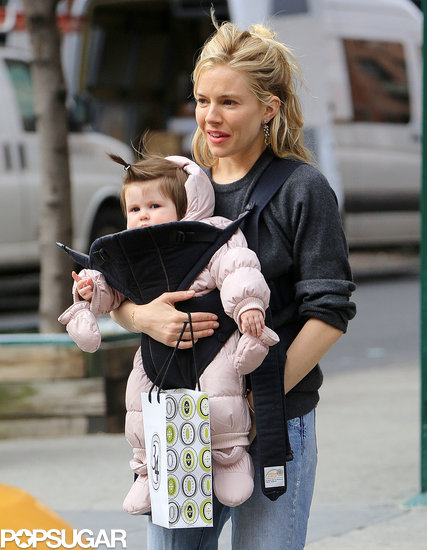 Sienna Miller carried Marlowe Sturridge while out shopping.