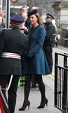 Kate Middleton wore a teal coat.