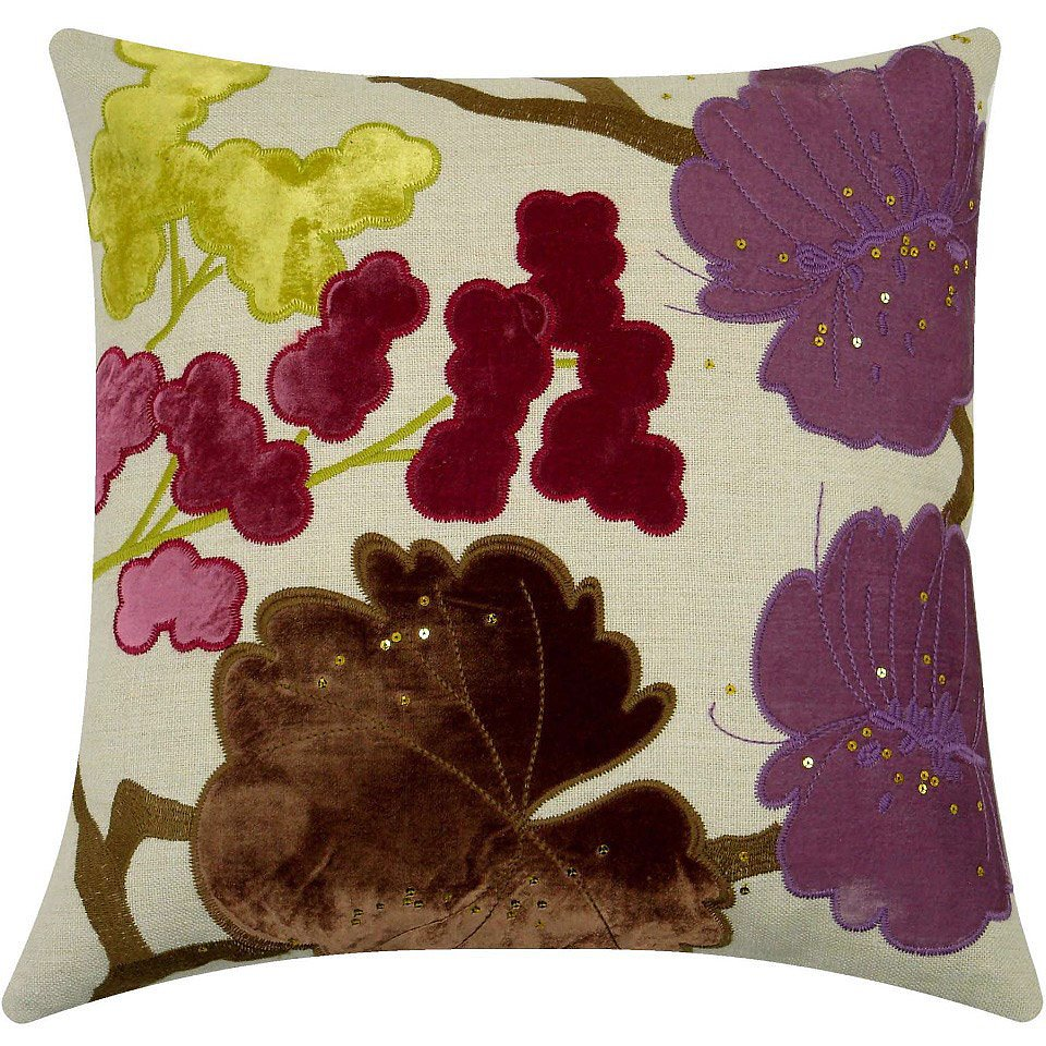 Deep colors and rich texture bring an air of elegance to this floral pillow ($192).