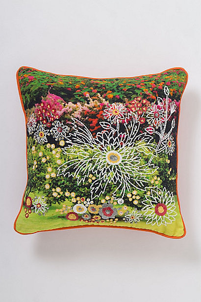 Add some color and shine to your space with this vibrant sequined floral pillow ($148-$178).