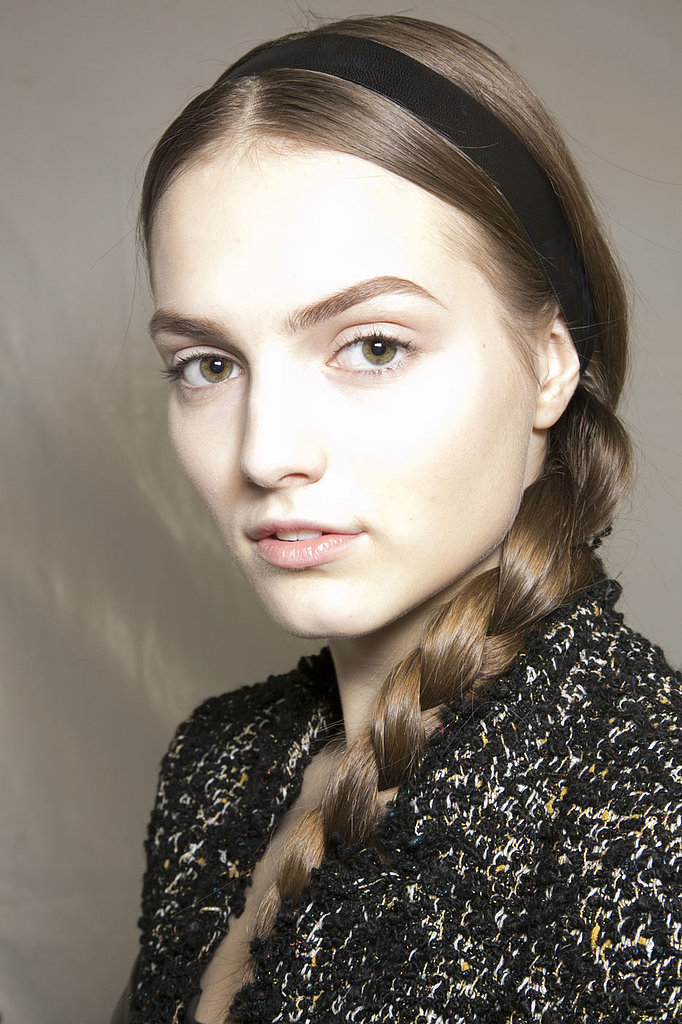 When in doubt, pair a simple side braid with a thin headband for a classic look, like Valentino showed for Fall 2013.