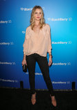 Rosie Huntington-Whiteley wore a pink blouse.