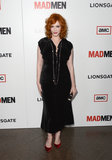 Christina Hendricks showed off her curves in a black velvet L'Wren Scott A/W '12 dress, which she accessorised with a long necklace and coordinating velvet red pumps.
