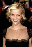 Sporting a shorter 'do, Reese attended the 2002 Academy Awards donning side-parted curls and polished makeup.