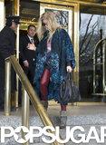 Fergie wore a leopard cape.