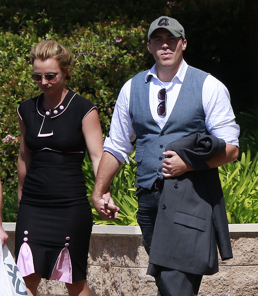 Britney Spears wore a black-and-pink dress, and David Lucado sported a baseball cap.