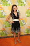 This was before The Vampire Diaries era — Nina Dobrev attended the 2009 Kids' Choice Awards in a sweet embroidered dress and gold peep-toe pumps.