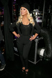 Christina Aguilera opted for an all-black, menswear-inspired look, including sequin suspenders and a top hat.