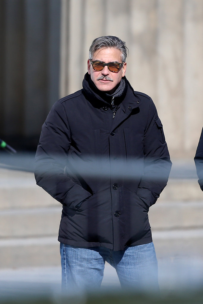 George Clooney kept warm while on set in Berlin.