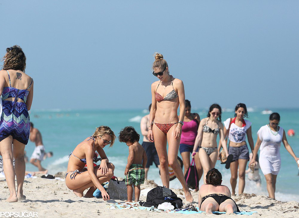 Bikini-clad Doutzen Kroes brought her son, Phyllon, along for a day at the beach in Miami with fellow Victoria's Secret angel Candice Swanepoel in March.