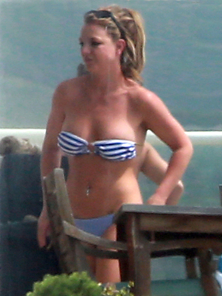 Britney Spears donned a striped bikini to soak up the sun with friends in Malibu.