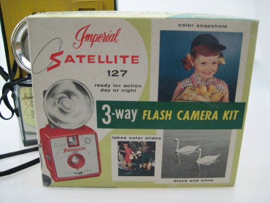 Who wouldn't want a 3-Way Flash Camera Kit when an adorable little girl with a pile of newborn baby chicks is selling it? Source: Etsy user TimelessHipster