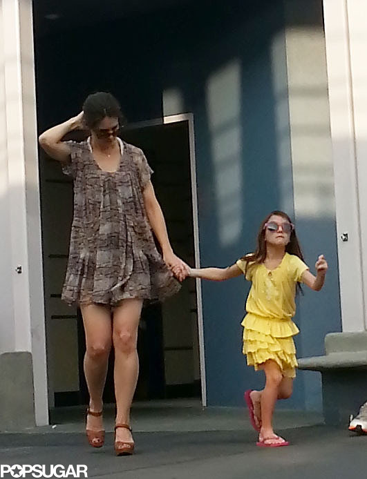 Katie Holmes held Suri's hand at Disney World.