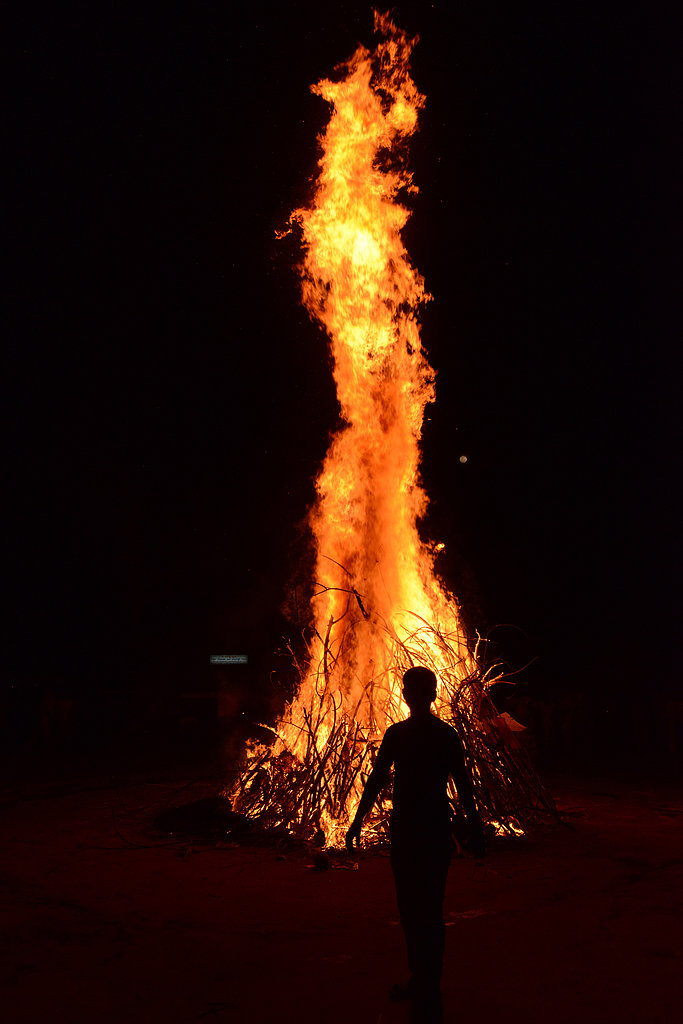 Hindu devotees participated in the Holika bonfire, which symbolizes the destruction of evil, to mark Holi in Ahmedabad, India.