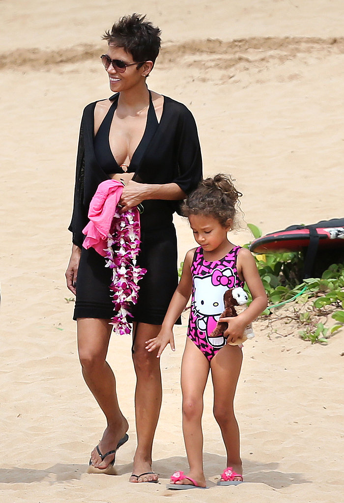 Halle Berry carried purple leis.
