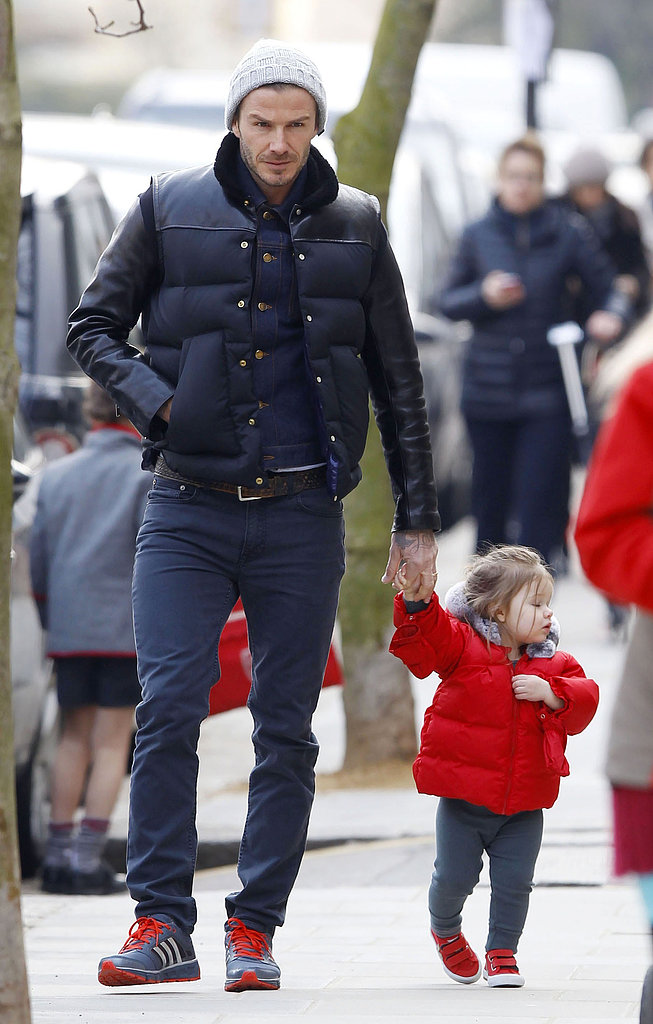 Harper Beckham held hands with David Beckham for a stroll around London.