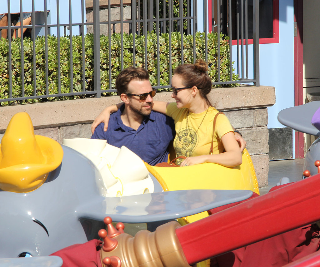 Olivia Wilde and Jason Sudeikis stuck close while riding the flying Dumbo ride during a March 2013 Disneyland trip.