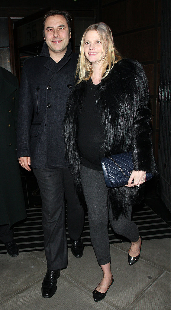 For date night with her husband, David Walliams, in London, a pregnant Lara Stone covered up in a black fur jacket, a black sweater, grey leggings, black flats, and a navy Chanel bag.
