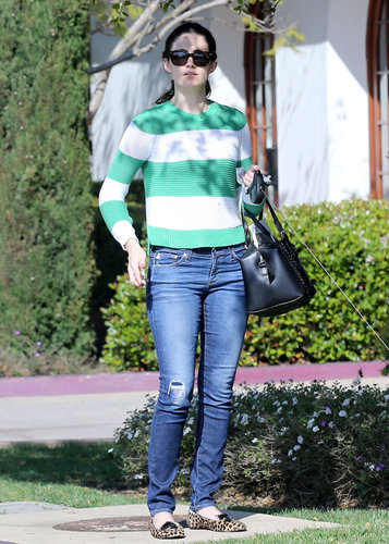 During a sunny Spring day out in LA, Emmy Rossum paired this vkoo green-and-white striped sweater ($178) with distressed denim, leopard loafers, and a Gerard Darel bag.