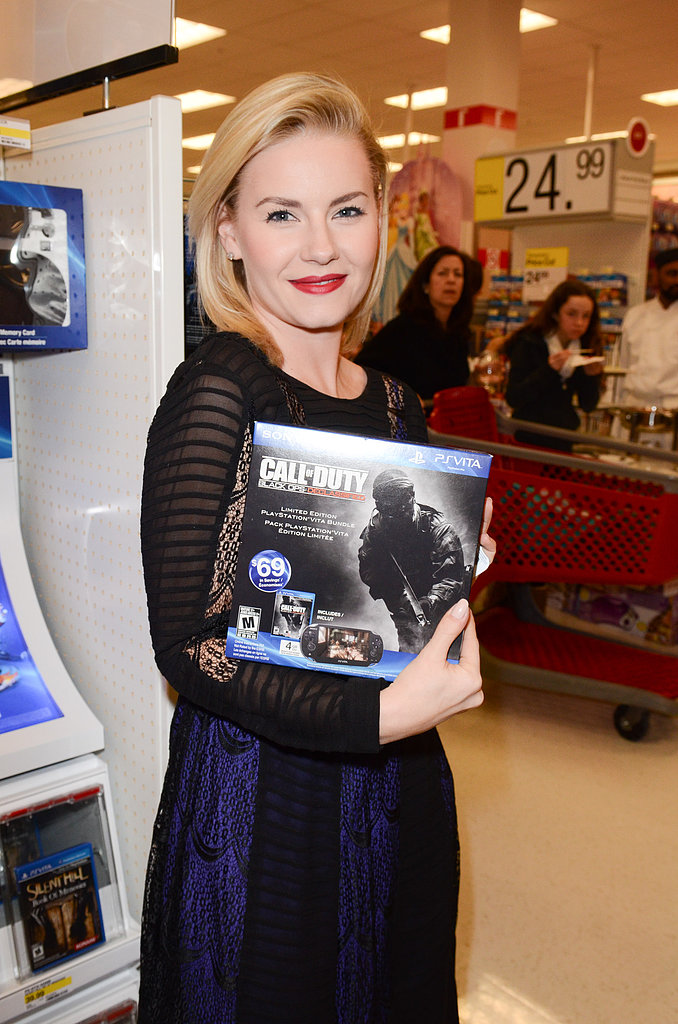 Elisha Cuthbert checked out Call of Duty gear.