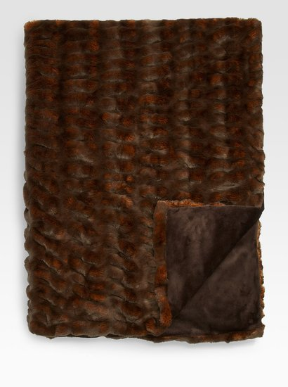 This fur throw ($349, originally $465) is inspired by Robb Stark's fur cape.