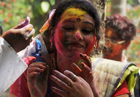 A woman took part in Holi in Siliguri, India.