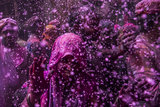 Purple powder sprinkled down on people in Vrindavan, India.