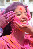 A girl got pink applied to her face in Amritsar, India.