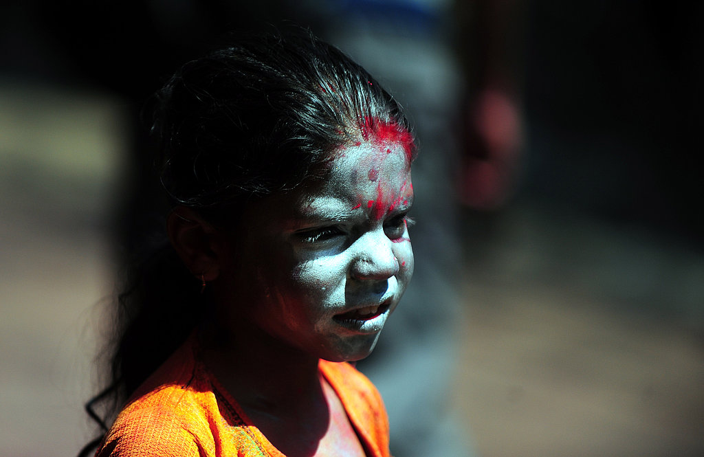 A little girl had powder on her face in Allahabad, India.