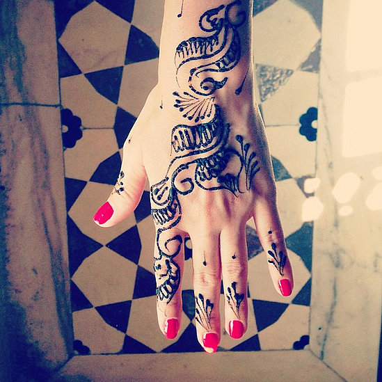 Lauren Conrad tried out a henna design to go with her red manicure while on vacation in India. Source: Instagram user laurenconrad