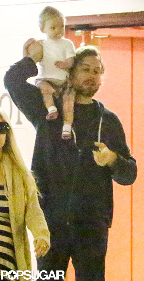 Maxwell rode on dad Eric Johnson's shoulders in LA.