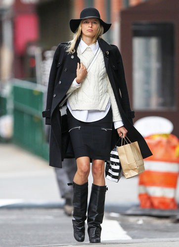 Karolina Kurkova made the NYC street her catwalk, bundling up in a chunky cable-knit sweater, black pencil skirt, and sexy leather boots.
