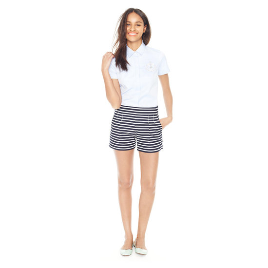 Add a preppy nautical twist to your look with striped shorts, then it finish off with a crisp top and flats.