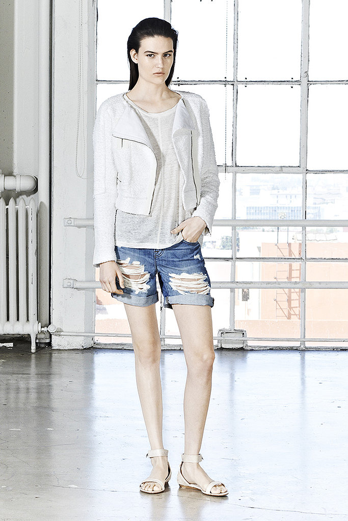 Here's a new way to rock your denim shorts: with a white biker-style jacket and a white tee.