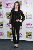 At WonderCon in Anaheim, Lily Collins stuck to a black-and-white color scheme in black leather pants, a black leather Michael Kors jacket, and a sheer black blouse with a white collar and cuffs.