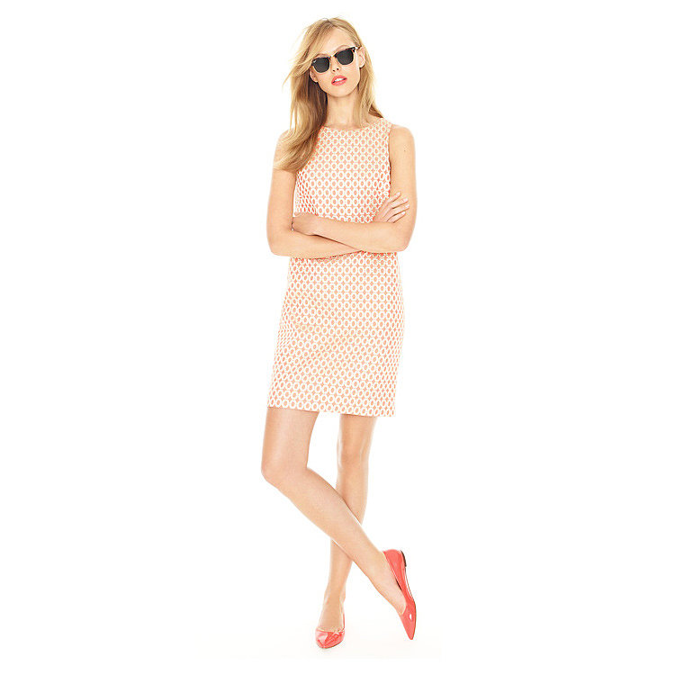 Instead of going all-out preppy in a printed sheath, add a little cool factor to this feminine silhouette with laid-back shades and bright flats.